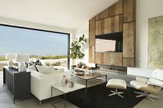 This modern home was designed to interact with its surrounding environment by Eric Olsen Design, located in Spyglass Hill, in Corona del Mar, California.