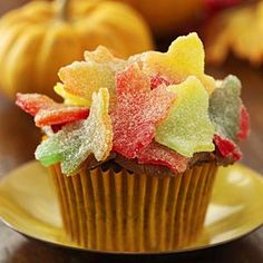 autumn leaves cupcakes...made by rolling out spiced gumdrops and using mini cookie cutters to cut out the leaf shapes...put on top of your favorite fall cupcake recipe