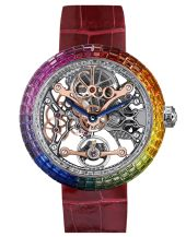 <p>The Brilliant Flying Tourbillon is a masterpiece of world-class gem setting artistry and spectacular high horology. The daring, imaginative and enticingly feminine timepiece features a richly colored dial showcasing the one minute flying tourbillon carriage with a power reserve of 100 hours. The stunning case is invisibly set with 403 baguettes and a beautiful rose-cut of natural gemstones.</p>
