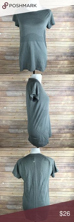 Lululemon grey shirt sleeve shirt size 12 This tee is in very good condition with no holes, no rips, or stains. lululemon athletica Tops Tees - Short Sleeve