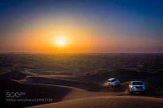 Sunset desert in UAE http://ift.tt/1PwaAJe beautifulbeautybluedesertdubaidunesemirateshorizonjeeplightmagentaorangesandskysunsunsettraveluaewaveswideyellow