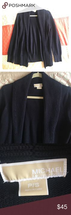 Michael Kors navy cardigan Michael Kors navy cardigan with ribbed shawl detailing. Worn once. 62% cotton, 38% rayon makes this cardigan durable and heavy for the colder months. Michael Kors Sweaters Cardigans