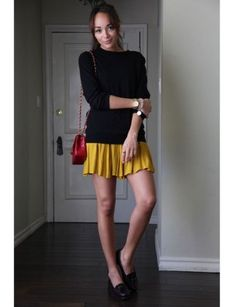 Revenge's Ashley Madekwe in a Yellow Pleated Skirt and Red Chanel Bag.