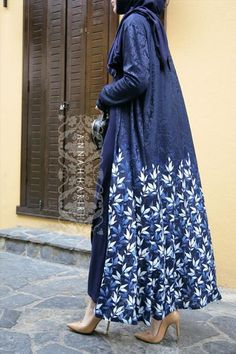 Beautiful long cobalt blue coat with details of leaves