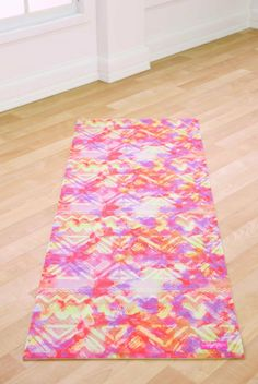 Brighten up your practice with this Sunset Festival yoga mat from Blogilates. Shop now at www.evolvefitwear.com.