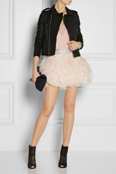 BALMAIN Embellished feather skirt $6,015 Olivier Rousteing explores a different side to Balmain's strictly party-glam aesthetic this season - this wispy feather mini skirt looks just as chic with street-style basics as it does with cocktail separates. Echo the edgy mood of the resort presentation and team this beaded design with a biker jacket and ankle boots.