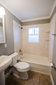 Updated Shower/Tub Combo with Light Wall Surround - Durabath Wall Surround - Corner Shelves - Window in the Shower - Bathroom Remodel - Bathroom Makeover - Brought to you by Re-Bath of the Triangle.
