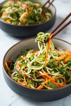 Spiralized, noodly, sweet and tangy sesame vinaigrette cucumber salad.