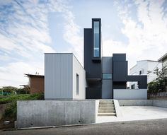 Built by FORM | Kouichi Kimura Architects in , Japan with date 2014. Images by Yoshihiro Asada. The house is located in the tiered-developed residential area on a hill. From the site, the beautiful scenery of the ...