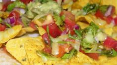 Nachos baked with bubbling Cheddar cheese and fresh tomato salsa make a bright and colorful snack for a party or watching the game.