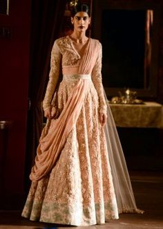 Model wearing peach colour gown for sabyasachi collection at Indian couture week July 2014