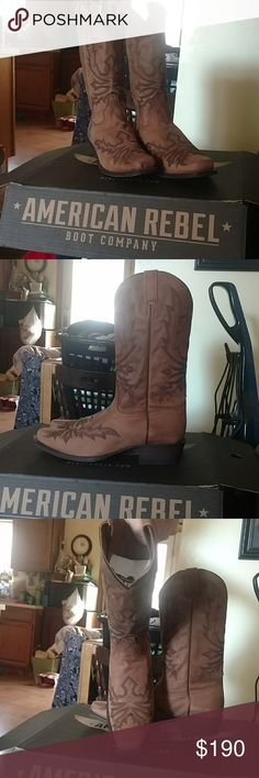 American Rebel Boot Company Brand new in the box,Never worn, Size 10.5 Male American Rebel cowboy boots. Square toe. American Rebel Boot Company Men's Venom Cowboy Boot – Classic Brown The Venom Boot by American Rebel packs potent style. It showcases the signature 'Venom' scorpion design, while the foot and upper are classic brown leather. Inside, leather lining lets your feet breathe, and a cushioned insole keeps you comfortable all day long. Get hardcore rebel style in the Venom Boot…