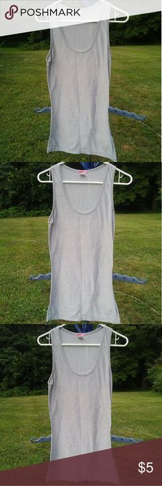 Silver Shimmer Stretchy Tank Top Silver Shimmer Stretchy Tank Top -57% Polyester/ 38% Lurex/ 5% Spandex -gently used; stain on bottom of front of shirt but its not noticeable unless your looking for it MaxRave Tops Tank Tops