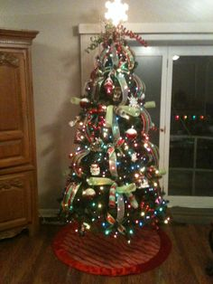my christmas tree chose multi colored lights for a different look added mesh ribbon mesh curls and 2 contrasting christmas ribbons with dove tail cuts - Decorating With Colored Christmas Lights