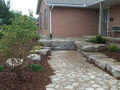 paver walkway with natural stone steps and walls