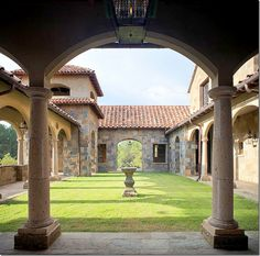 The Front Courtyard:  to the left is the bell tower and in the center of the courtyard is a sun  dial.