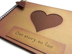 This is a simple A4 rustic style scrapbook with thick Brown Kraft card covers and quality plain/blank deep burgundy card sheets for pages - you can choose the number of sheets included from the drop down menu. The front cover is lightly inked and has a heart cut out so you can see through to the first page. The sentiment reads Our story so far. The book is bound with black binding wire and it comes with a coordinating burgundy heart tag strung with rustic Brown twine. Lovely rustic vinta...