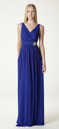 "Surplice style V-neck bridesmaid dress with built-in waistband. Waistband hits slightly above the natural waist. Shown here as a full length ""J"" skirt in cobalt georgette. Accessorized with our rhinestone brooch (sold separately). Fully lined, made in USA. www.ariadress.com"