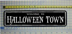Hey, I found this really awesome Etsy listing at https://www.etsy.com/listing/170317304/welcome-to-halloween-town-sign-nightmare