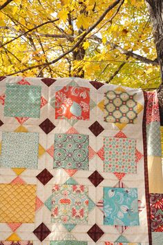 """Square Dance"" a big block quilt to show off the large print fabrics you love"