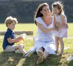 Happy families: Kate appeared to tickle Princess Charlotte while Prince George, four, enjo...