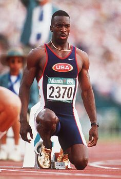 Michael Johnson wins 200m and 400m sprint double at 1996 Olympics