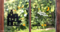 Windows are an easy place to showcase some of your Halloween decor.  Add an image of an haunted village, paired with some ghosts and pumpkins.