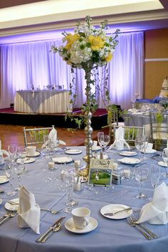 Yellow and White Elevated Arrangement. Photo by Carrie Wildes Photography Tampa.  www.abweddingstampa.com