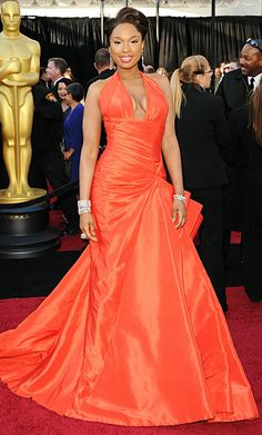 Jennifer Hudson looked stunning in her tangerine orange Atelier Versace gown for the Oscars 2011. She completed the look with $1 million worth of Neil Lane jewels. Well done!