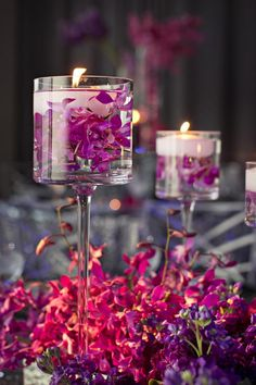 Floating Candles in Glass Vases — The Perfect Palette proves you don't always have to use tall vases for floating candle centerpieces. Here are some lovely wedding table centerpieces using tall stemware instead. The fresh flowers around the base enhance the whole look. #centerpieces #floatingcandles #diy #brightideas
