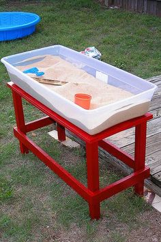 Plastic bins are great for a backyard sand table. Just put the lid on when you're done!