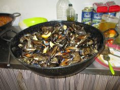 Giant pan of mussels (mejillones) being cooked at birthday bash in La Nucia Spain