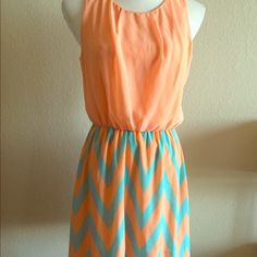 "Pink Owl Tangerine and Mint Chevron Dress This dress is SO cute. Features a chevron skirt in Aqua (mint) and tangerine with a coral chiffon top. Keyhole back, elastic waistband. Super comfy and easy to fit. I have changed sizes otherwise I would keep it! Mini, but not TOO short (I'm 5'9"" and didn't feel like it was vulgar or anything!) Originally from Red Dress Boutique Pink Owl Dresses Mini"