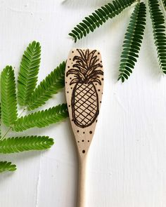 Wood burned pineapple wooden spoon Personalized decorative wooden spoon, great for a wooden anniversary gift. A pyrography spoon, even a wedding spoon. Thoughtful gift for the baker in your life. This unique wooden spoon is perfect for display as wood burned art or as a regular kitchen