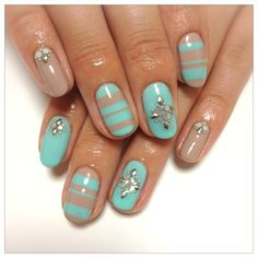 turquoise/nude gemmed nails