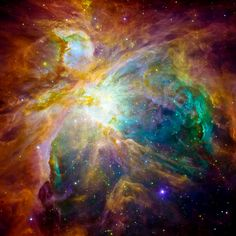 """An image from NASA's Spitzer and Hubble Space Telescopes looks more like an abstract painting than a cosmic snapshot. The magnificent masterpiece shows the Orion nebula in an explosion of infrared, ultraviolet and visible-light colors. It was """"painted"""" by hundreds of baby stars on a canvas of gas and dust, with intense ultraviolet light and strong stellar winds as brushes."""