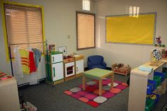 More Than ABC's and 123's: Preschool Classroom Set up! Chart holder repurposed for hanging dress up