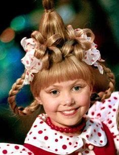Cindy Lou Who is an iconic Christmas character that represents everything good. Check out these tips on how to do Cindy Lou Who hair and makeup this year for your Christmas parties and events! #Christmas #CindyLouWho #ChristmasHairstyles #ChristmasHair