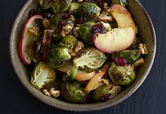 This easy fall side dish combines roasted brussels sprouts and apples with dried cranberries, chopped walnuts, and a drizzle of maple syrup. Delicious!