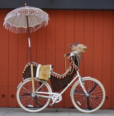 My favorite art bike so far. I was already thinking of adding a parasol, and the layered fabric is so do-able.