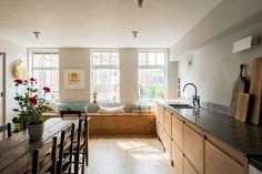 Located on the top floor of a Victorian school conversion, Cassandra Ellis's split-level apartment is up for sale (a bit of context: we've admired it befor