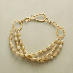 """GOLDENLOCKS BRACELET--Shot through with nature's striations heightened by 22kt vermeil accents, golden rutilated quartz emits a wondrous warmth. Hook clasp. Handmade in USA. 7-1/2""""L."""