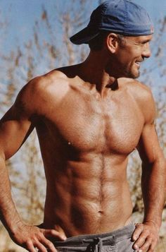 Shirtless silver fox hottie with a great smile and backwards baseball cap