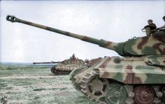 """Two Panzer VI """"Tiger II"""" (King Tiger) with Porsche turret on flat terrain;. PK KBZ Western Command France June 1944"""