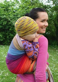 Babywearing glossary. Info on different types of carriers, pros and cons of each, suggested brands, and different ways to tie them.