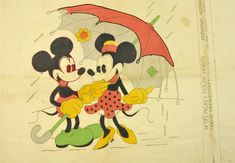 This is a vintage Mickey and Minnie Mouse, under an umbrella, Vogue needlecraft pattern, No. 98, Mickey Mouse Series, 1931. This pattern was