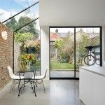 Rise Design Studio has added a glazed extension to the rear of a house in London, creating a light-filled kitchen and dining room that opens up to the garden. With the demand for contemporary house extensions continuing across the capital, the London-base Design Studio, House Design, Brick Siding, Glass Extension, Side Extension, Garden Windows, London House, Glass Roof, Skylight Glass