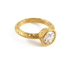 A favorite: 22k hand-engraved Gold with a spectacular 2+carat Diamond...