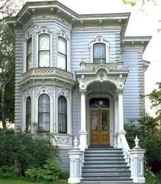 Lovey architectural detail on this little house.  Nice bay windows, too!