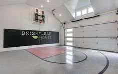 Is there anything cooler than an indoor basketball court? This detached garage was finished - Vine Ideas Home Basketball Court, Basketball Court Flooring, Basketball Room, Sports Court, Boat Garage, Garage Gym, Garage House, Custom Home Builders, Custom Homes